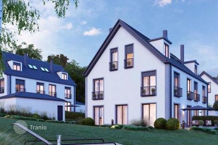 Luxury houses for sale in Starnberg. Half of the house with views of the Alps and Lake Starnberg, Bavaria