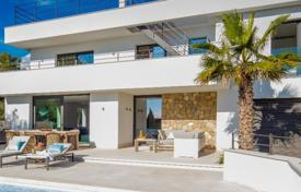 Luxury houses for sale overseas. New villa with a pool and a terrace with sea views, close to the port of Adriano and several golf courses, Nova Santa Ponsa, Mallorca