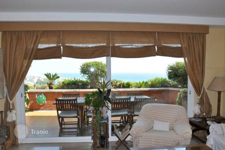 Apartments with pools for sale in Catalonia. Two-levels duplex in Castelldefels, Spain. Property in a residence near the beach