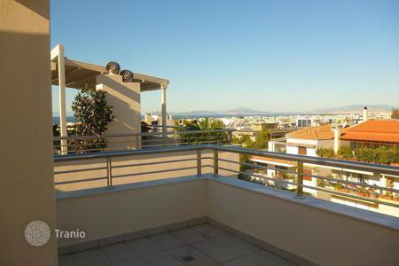 Apartments for sale in Greece. New apartment in the area of Ano Glyfada with a pool on a plot home