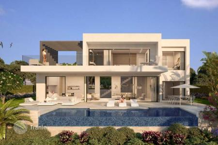Residential for sale in Andalusia. New three-level villa with pool and garden in Estepona, Costa del Sol
