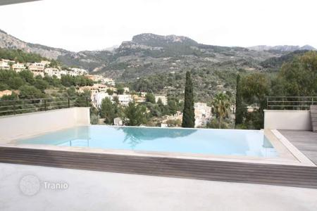 Houses for sale in Soller. Minimalist styled chalet in exclusive residence in Puerto de Soller