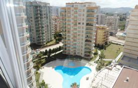 Apartments with pools by the sea for sale in Western Asia. Spacious penthouse in a residential complex in Mahmutlar
