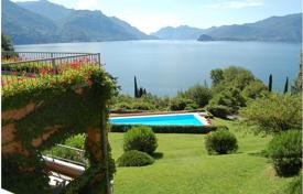 Apartments with pools for sale in Lake Como. Apartment with a terrace and a lake view in a residence with a swimming pool and a parking, Menaggio, Italy