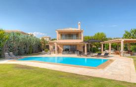 Luxury houses with pools for sale in Peloponnese. A lovely two-storey villa in the first sea line in the Peloponnese