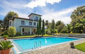 Houses for sale in Basque Country. Three-storey villa with a spacious swimming pool, a terrace and a large landscaped garden, Cantabria, Bilbao, Spain