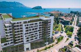 Coastal new homes for sale in Budva (city). 2 bedroom apartment in frontline multifunctional complex