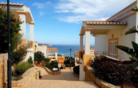 Coastal townhouses for sale in Algarve. Townhouse with terrace and garden in a new residential complex in 500 meters from the beach of Salema, Algarve, Portugal