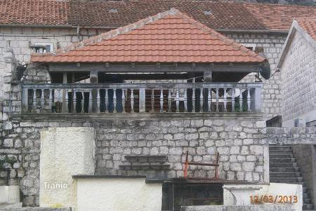 "5 bedroom houses by the sea for sale in Kotor. Old stone property right on the first line to the sea in one of the best locations in Kotor, Dobrota †""sunny side of Bay. House has 210 m²"