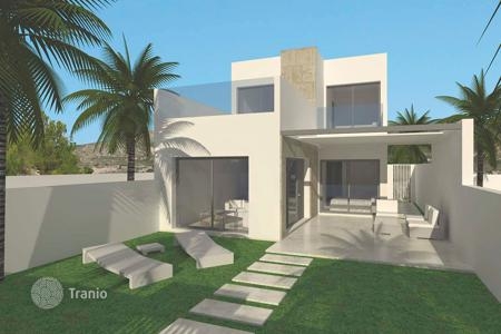 Cheap townhouses for sale in Valencia. Large terraced houses with basement in Benijofar