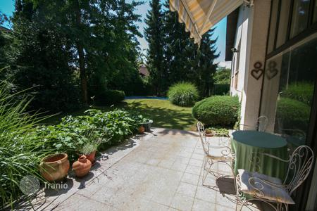 Houses for sale in Ljubljana. This lovely, spacious house is hidden in a beautiful garden only a few minutes drive from the city center