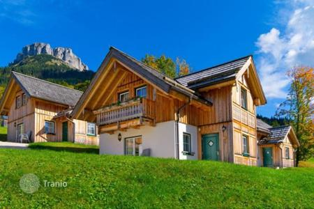 Cheap houses for sale in Central Europe. The two-story chalet with a sauna at the lake in Altaussee, Austrian Alps