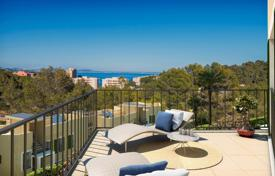 3 bedroom apartments for sale in Balearic Islands. Two-level apartment with a garden, a solarium and a sea view in Cala Vinyes, Mallorca