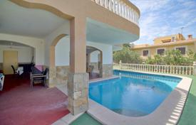 5 bedroom houses for sale in Balearic Islands. Two-level furnished villa with a private garden, a pool and a garage, Calvia, Spain