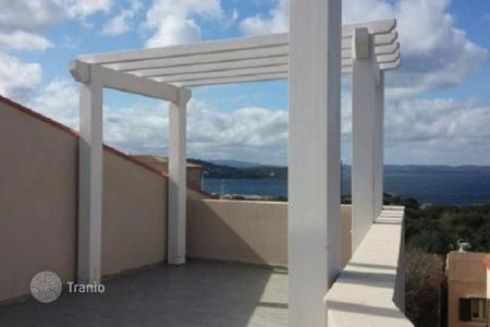 Coastal apartments for sale in La Maddalena. Two-bedroom loft with a large roof terrace with magnificent views of the sea in La Maddalena, Sardinia