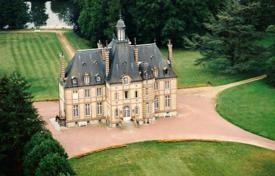 Chateaux for sale in France. Medieval castle with a picturesque garden and additional buildings, next to Sarthe river, Le Mans, France
