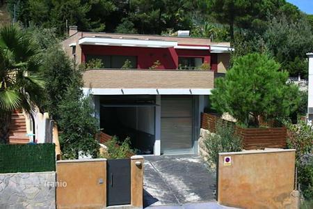 Houses for sale in Catalonia. Designed villa with separate apartment, garden and mountain view, not far from the beach, in Lloret de Mar, Girona, Spain