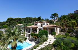 Luxury 4 bedroom houses for sale in Vallauris. Luxury villa with a pool, terraces and a Mediterranean garden with fruit and olive trees, Valloris, Côte d'Azur