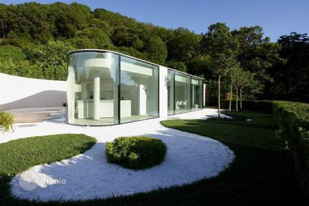 Luxury houses with pools for sale in Central Europe. Glass Villa in Brusino Arsizio, Switzerland