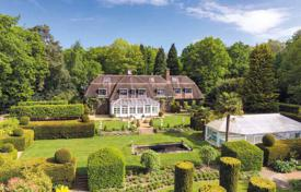Houses for sale in the United Kingdom. Manor with stables and a large garden in the heart of the Surrey Hills