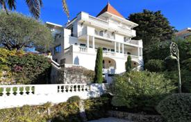 4 bedroom houses for sale in Cannes. Beautiful villa with a pool, a garden, a terrace and sea views, Cannes, France