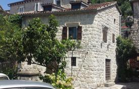 2 bedroom houses for sale in Kotor. Unique waterfront old stone house on two floors, has 90 square meters. It is located in Perast in the Bay of Kotor in the first sea line.