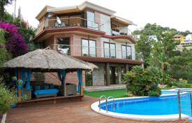 4 bedroom houses for sale in Spain. Unique villa with a pool, a garden and stunning sea views, Lloret de Mar, Spain