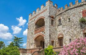 Houses for sale in Florence. Beautifully restored medieval castle with a plot of forest in Tuscany