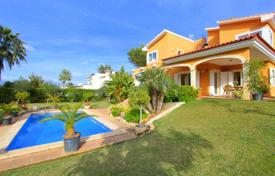 5 bedroom houses for sale in Balearic Islands. Villa with a private garden, a pool and a garage, Santa Ponsa, Spain