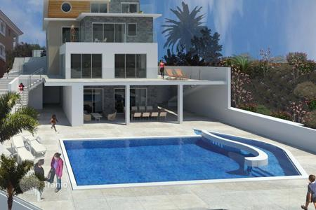 Luxury houses with pools for sale in Agios Tychon. Four Bedroom Detached Villa with Sea View