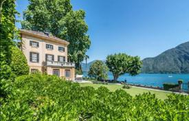 Houses for sale in Lombardy. Unique villa of the 19th century with a large park, an orangery and Elling on the first line of Lake Como, Italy