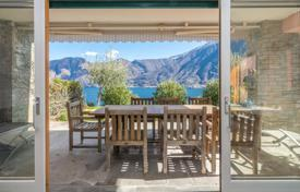 Coastal residential for sale in Sala Comacina. Two-bedroom apartment with a private garden and views of the mountains and the lake in Sala Comacina, Lombardy, Italy