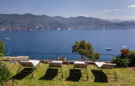 Mediterranean style villa with stunning views of the Gulf of Paraggi and the olive grove in Portofino, Liguria, Italy. Price on request
