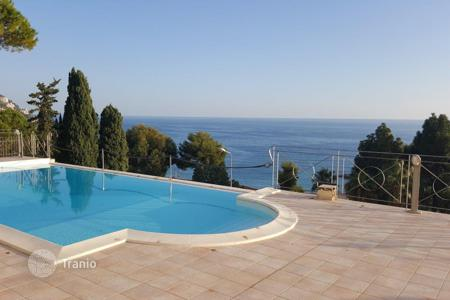 Luxury 5 bedroom houses for sale in Liguria. Villa with pool, garden and stunning views of the sea and the city in Ospedaletti, Liguria, Italy