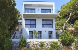 Houses with pools by the sea for sale in Provence - Alpes - Cote d'Azur. New three-storey villa with an indoor pool, a terrace and sea and mountain views, Eze, France