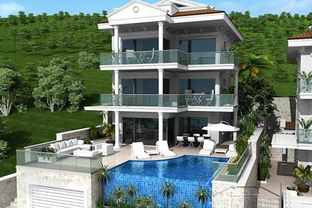 5 bedroom houses for sale in Western Asia. New villa with infinity pool and a rooftop terrace with spectacular views of the sea in Kisla, Kalkan, Turkey