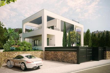 5 bedroom houses for sale in Majorca (Mallorca). Modern villa with garden and salt water swimming pool in Nova Santa Ponsa, Mallorca, Balearic Islands, Spain