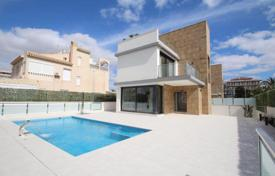 Houses with pools by the sea for sale in Alicante. Exclusive villas 100 meters from the beach in Punta Prima, Alicante, Spain