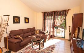 Townhouses for sale in Catalonia. Townhouse with garden, pool and parking 180 meters from the sea, next to the park and a forest in Lloret de Mar, Catalonia, Spain