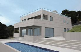 Houses with pools for sale in Tarragona. Modern four-storey villa with a pool, a garden and a terrace, with panoramic sea views, Cambrils, Spain