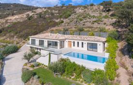 4 bedroom houses for sale in Grimaud. Modern villa with a sea view, a plot, a pool, terraces and a garage, Grimaud, France