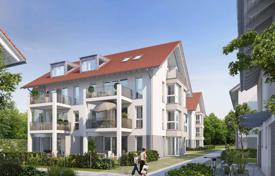 Houses for sale in Bavaria. Four-level duplex with terrace and garden in a new residential complex in a suburb of Munich, Parsdorf