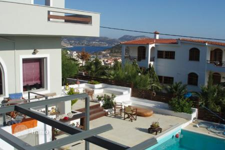 3 bedroom houses for sale in Lagonisi. Sea view estate with two buildings, a large swimming pool and a landscaped garden, Lagonissi, Greece