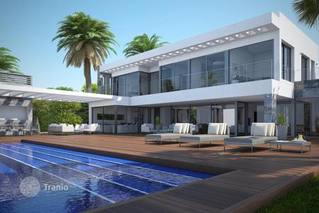 Luxury residential for sale in Benitachell. New villa with pool and garden on the seafront in Cumbre del Sol, Costa Blanca