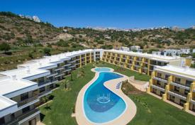 Apartments with pools for sale in Portugal. New two-bedroom apartment in a luxury complex with a swimming pool, Albufeira, Portugal