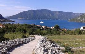 Coastal development land for sale in Kotor (city). Old stone house of 91 m² with sea view situated on 3279 m² plot of land in Risan, Kotor Riviera