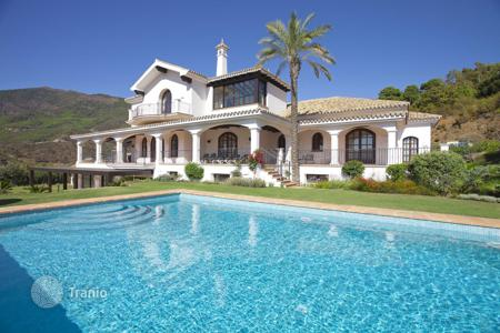 Luxury 5 bedroom houses for sale in El Madroñal. Three-storey furnished villa with cinema, spa, swimming pool and stunning mountain views in La Zagaleta, near El Madronal, Malaga