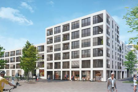 New homes for sale in Munich. Three-bedroom apartment in Munich, Germany, Terrace, balcony, new residential complex with a green courtyard, district of Schwabing-Freimann