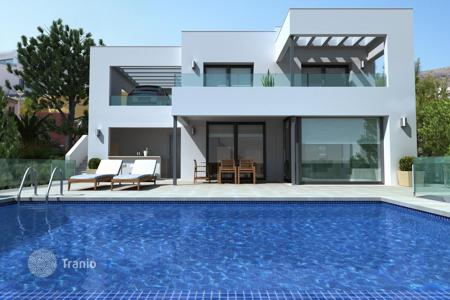 Houses with pools for sale in Cumbre. Modern villa with panoramic sea views, in a complex with the equipped adjacent territory, pool and parking, Benitachell