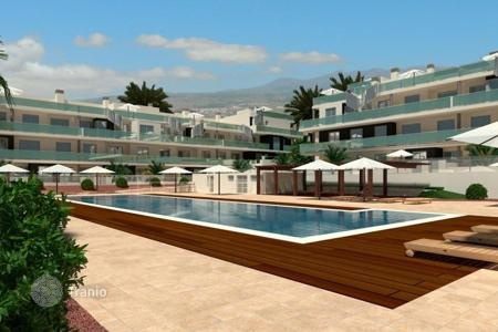 New homes for sale in Tenerife. New apartment with a terrace and a view of the mountains, in a residence with two swimming pools and a vista point, near the beach, Tenerife